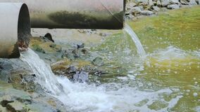 Drain pipe or effluent or sewer release wastewater into river