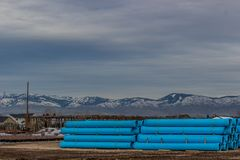 Drain pipe staged for winter road construction in Boise Idaho Stock Image