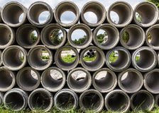 Drain pipes. Piled up concrete drain pipes stock image