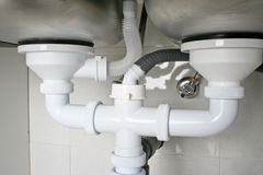 Drain pipes. Under a kitchen sink with dishwasher connection royalty free stock photography