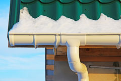 The drain PVC. To the roof of country home in winter Royalty Free Stock Images