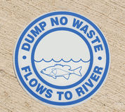 Drain sign - Dump no waste flows to river Stock Images