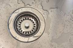 Drain sink. Hole in a metal sink royalty free stock photography