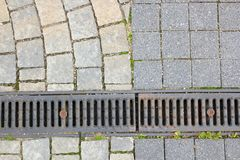Drain and stone pavement Royalty Free Stock Photography