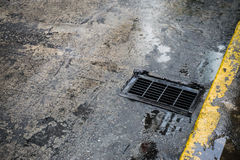 The drain. The street drain for raining stock photography