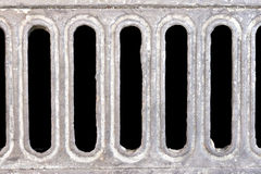 Drain water. Background image of a floor drain water over a black background stock photography