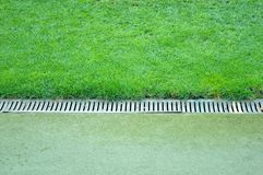 Drainage ditches on stadium. Close up of drainage ditches on stadium stock photo