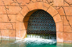 Drainage gate on old building Royalty Free Stock Photography