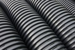 Drainage pipes. Closeup of black drainage hoses Royalty Free Stock Photo