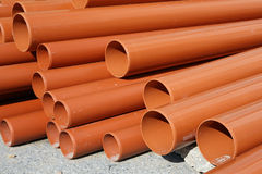 Drainage Pipes. Stacked PVC drainage pipes on a construction site Royalty Free Stock Photos