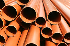 Drainage Pipes. Stacked PVC drainage pipes at a construction site Stock Photos