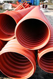Drainage pipes. On building site. Orange plastic tubes or building materials in pvc Royalty Free Stock Images