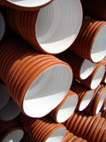 Drainage pipes. Pile of drainage pipes in construction site Stock Images