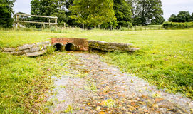 Drainage Pipes disguised as a bridge. These drainage pipes have been tastefully disguised under ground, and built up to resemble a small bridge. Situated in a Royalty Free Stock Images