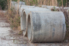 Drainage pipes was left in the meadow and deterioration. Royalty Free Stock Image