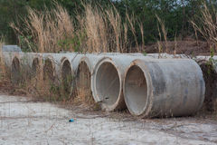 Drainage pipes was left in the meadow and deterioration. Stock Photo