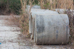 Drainage Pipes Was Left In The Meadow And Deterioration. Royalty Free Stock Photography