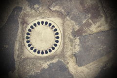 Drainage on stone paved street Royalty Free Stock Images