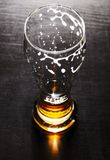 Drained glass of lager beer on table Stock Images
