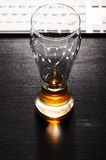 Drained glass of lager beer on table Royalty Free Stock Photography