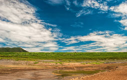 Drained lake. And blue sky in sunny day Royalty Free Stock Photography