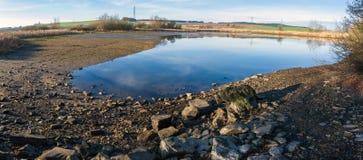 Drained pond in winter. Against blue sky, rural scene, landscape Stock Images