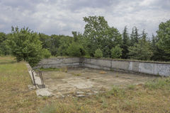 Drained and Ruined swimming pool. In the nature Royalty Free Stock Photo