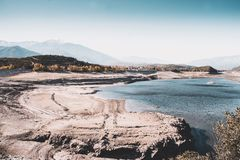 Drained Vinca barrage with a view to Canigou peak. View to snowed Canigou peak from drained Vinca barrage, Eastern Pyrenees, France stock photos