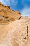Drained water canal in sanstone rocks of Wadi Rum Royalty Free Stock Photo