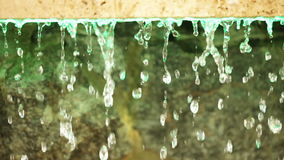Drained water. Drops of water flowing down from granite slabs stock video