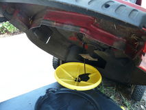 Draining Lawn Mower Oil for Change Royalty Free Stock Photography