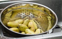 Draining the Potatoes Royalty Free Stock Photos