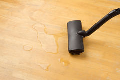 Draining water with vacuum cleaner Stock Photography