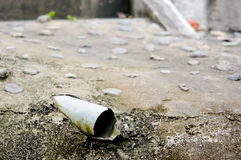 Drainpipe in cement ground Stock Images
