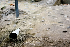 Drainpipe in cement ground Stock Photo