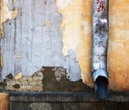 Drainpipe en la pared Imagen de archivo libre de regalías