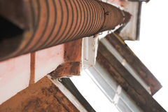 Drainpipe. That goes up the house near the balcony, beautiful facade, view from below Royalty Free Stock Photography