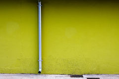 Drainpipe on a Green Wall Royalty Free Stock Photos
