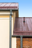 Drainpipe and metal roof Royalty Free Stock Photography