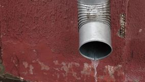 Drainpipe in the rain stock video footage