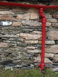 Drainpipe on rustic building Stock Image