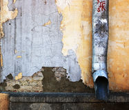Drainpipe on the wall Royalty Free Stock Image