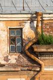 Drainpipe and window Royalty Free Stock Photos