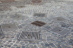 Drains in the city. Close up picture of a drains in the middle of a romanian city Stock Photo