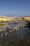 Drakensberg stream. Beautiful stream in the Drakensberg with the berg in the background Stock Images