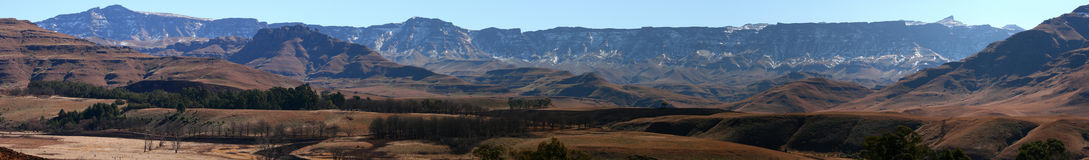 Drakensberg Wide Angle View From Castleburn. South Africa in winter with snow on mountain and recently burnt grass Stock Image