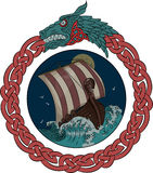 Drakkar sailing on the stormy sea in the night, in the frame of the Scandinavian wreath with a dragon`s head Stock Photography