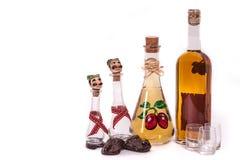 Dram and plum brandy bottle Royalty Free Stock Photos