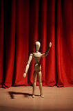 Drama. Wooden mannequin performing a drama Stock Photos