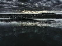 Drama edited sea. Clouds over the sea stock photos